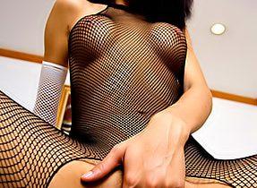 Slender T-Girl In Fishnet Outfit