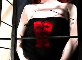 Redheaded Transexual Caged