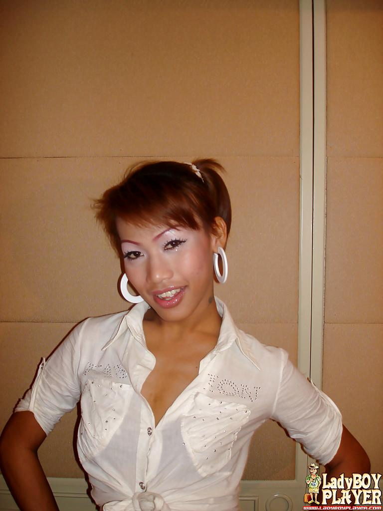 Cute Redheaded Thai Ts Monika And Her Petite Boobs Pose In Shorts