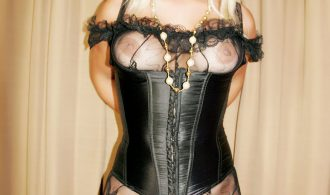 Massive Breasts Blonde TS In A Corset And Bodystocking