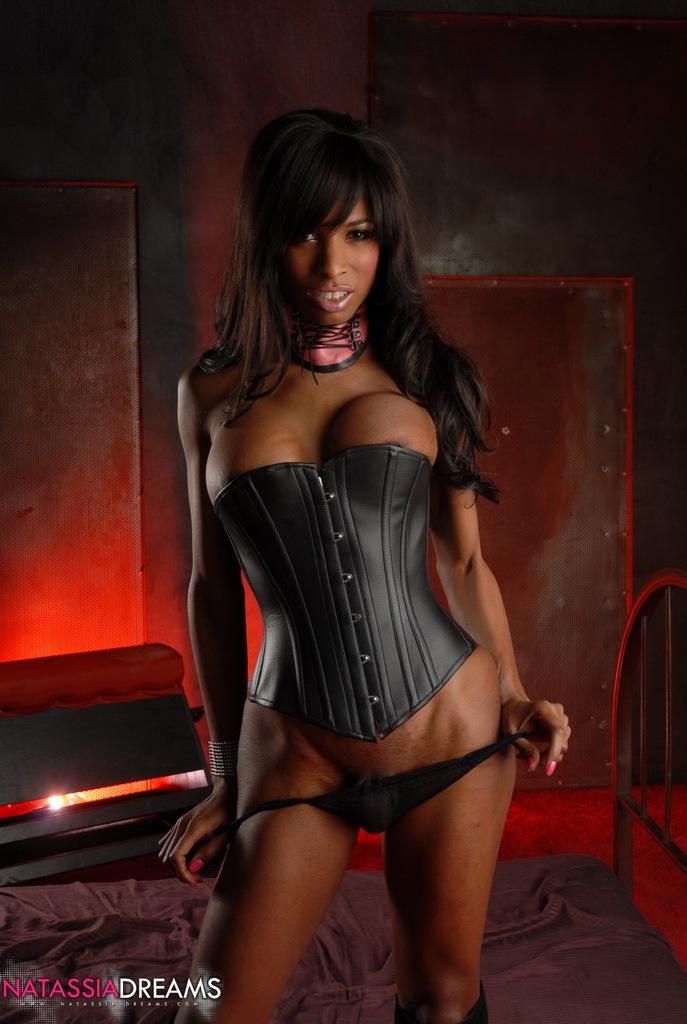 Sensuous Ebony Femboy Natassia Posing In Steamy Black Corset