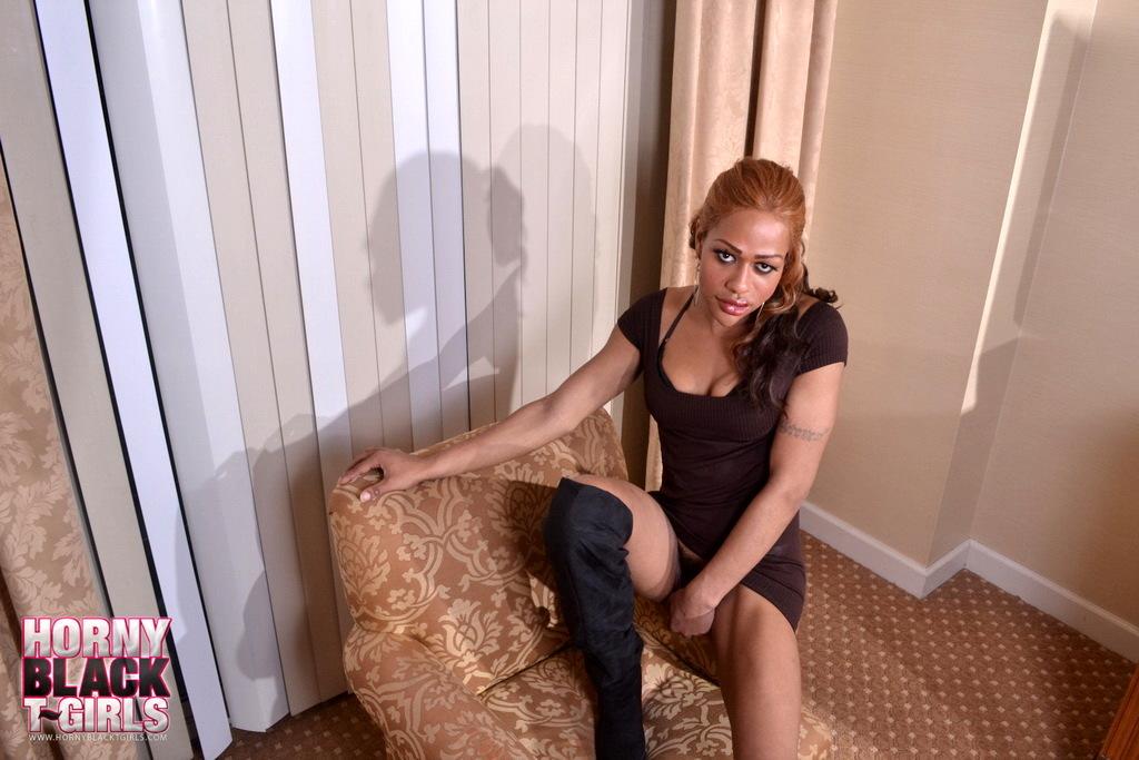 Gorgeous Chocolate Transsexual Sparkle Posing On Sofa